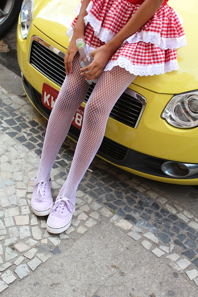 Lovely legs rest on a taxi.