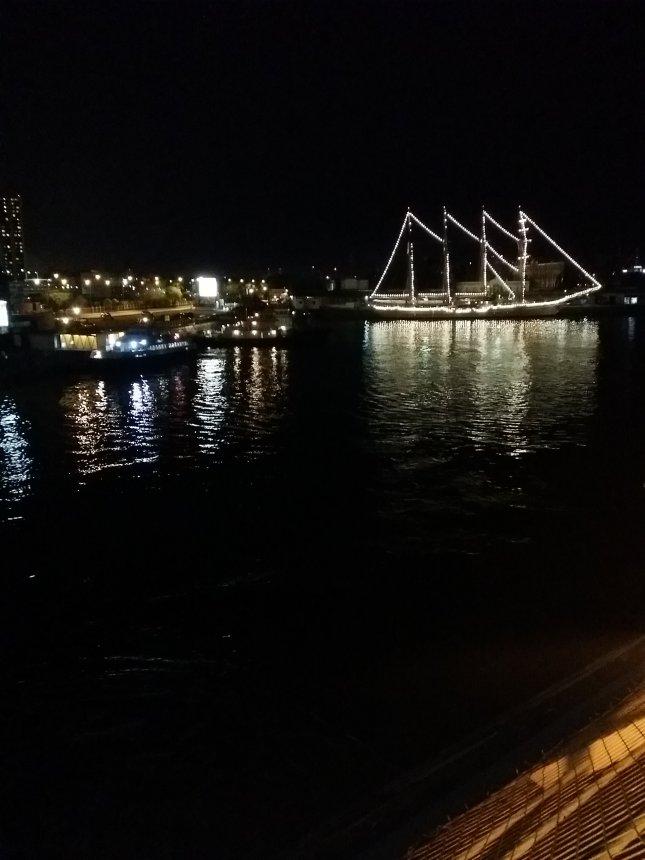 Puerto Madero y a small illuminated boat.